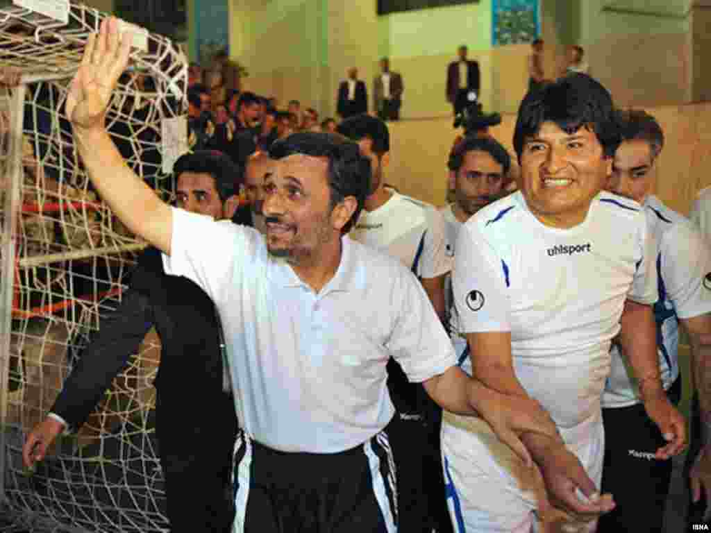 Iran's President Mahmud Ahmadinejad (left) and his Bolivian counterpart Evo Morales play a game of soccer in Tehran on October 27.Photo by ISNA