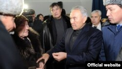 President Nursultan Nazarbaev (second from right) meeting with officials in the region a week after the deaths in Zhanaozen in December 2011.