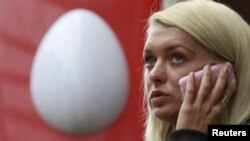 A woman speaks on the phone near an office of Russia's mobile phone operator MTS in Moscow. (file photo)