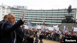 Bulgaria -- Outgoing Prime Minister Boyko Borisov waves to supporters outside the parliament in Sofia, 21Feb2013
