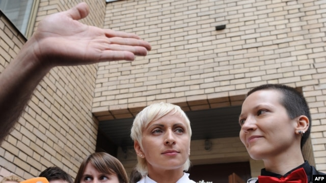 Irina Shapitko (right) and Irina Fedotova-Fet exit a wedding registration office in Moscow on May 12.