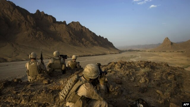 U.S. Marines keep watch on a hilltop during a patrol in Helmand Province on September 21.