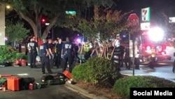 Полиция қызметкерлері төтенше оқиға болған клубтың жанында тұр. Флорида штаты, АҚШ. 12 маусым 2016 жыл.