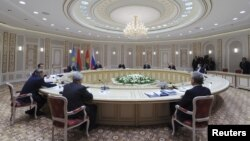 Belarus - Russia's President Vladimir Putin (2nd R, facing the camera) and other participants attend a session of the Supreme Eurasian Economic Council at the Palace of Independence in Minsk, October 24, 2013.