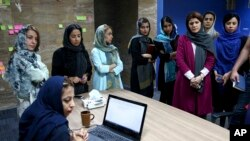Staffers of the Bamilo online shopping site attend a meeting at their office in Tehran, Iran.May 22, 2017 (AP Photo/Ebrahim Noroozi)