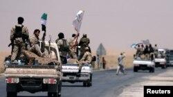 """Ракканы """"Ислам мемлекеті"""" экстремистік тобы содырларынан азат ету операциясына қатысушылар. Сирия, 6 маусым 2017 жыл."""