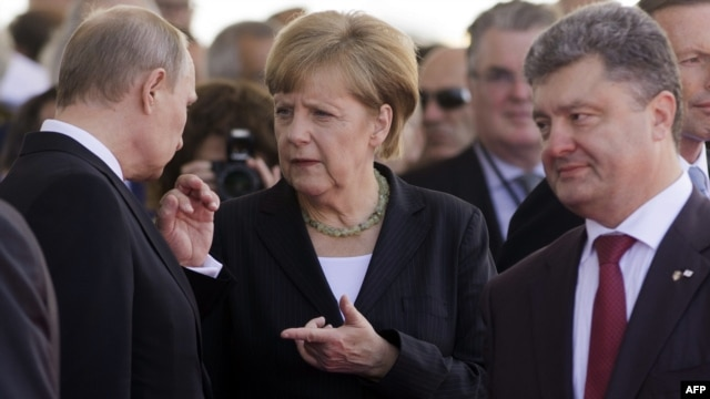 The visit of German Chancellor Angela Merkel (center) to Kyiv this weekend has raised hopes that she may be able to help Russian President Vladimir Putin (left) and Ukrainian President Petro Poroshenko strike a deal that would end the Ukraine crisis. (file photo)