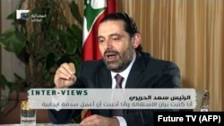SAUDI ARABIA -- An image grab taken from the Hariri family-owned Lebanese channel, Future TV, shows Lebanese resigned prime minister Saad Hariri speaking during an interview from Riyadh, November 12, 2017