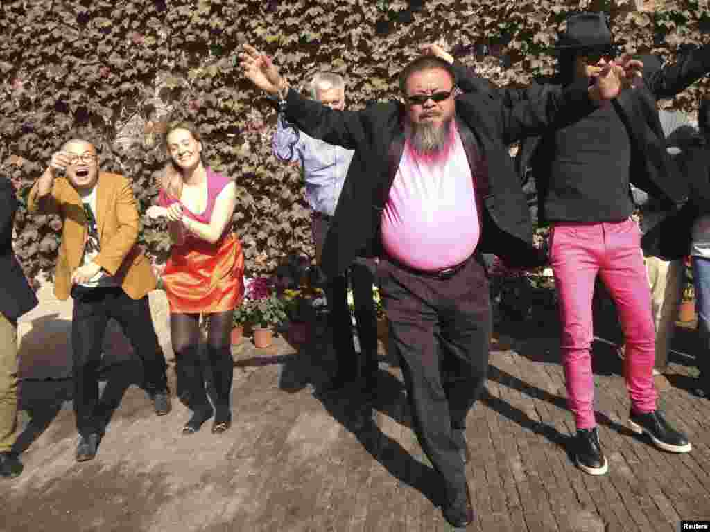 "Dissident Chinese artist Ai Weiwei (front) dances with his friends as they make a cover version of the music video of ""Gangnam Style"" by South Korean singer Psy in the courtyard of Ai's studio in Beijing. (Reuters/Courtesy of Ai Weiwei)"