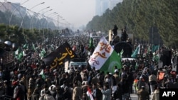 Tens of thousands of supporters of cleric Muhammad Tahir-ul-Qadri gathered at a protest rally in Islamabad on January 15.