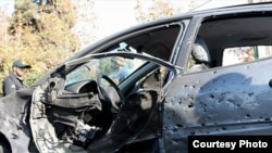 Vehicle of Fereidon Abbasi professor of Shahide Beheshti university after bomb attack