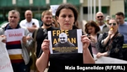 Leyla Mustafayeva, wife of Azerbaijani journalist Afqan Muxtarli, leads a June 1 protest in Tbilisi against her husband's reported forced return to Azerbaijan.