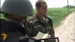 Ukrainian Soldiers Inspect Cars At Checkpoint Near Slovyansk