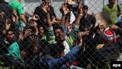 Migrants from Afghanistan and Pakistan protest against deportations in the detention center for migrants in Moria, Lesbos island, Greece, on April 5.