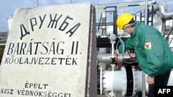A Hungarian engineer checks the pressure at a refinery plant of the receiving station of the Druzhba oil pipeline in Szazhalombatta.