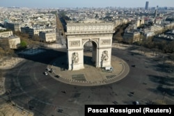 France's Arc De Triomphe stands above deserted streets on April 1, 2020. The current coronavirus pandemic has spread throughout the world, killed more than 90,000 people, and shut down huge segments of the world's economy.