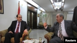 Iraqi Prime Minister Nuri al-Maliki (left) meets with former Prime Minister and head of the Al-Iraqiyah coalition Iyad Allawi in Baghdad last month.