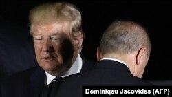 Donald Trump (solda) və Recep Tayyip Erdoğan 2019-cu ilin G20 sammitində