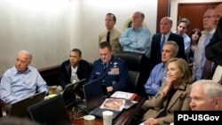 John Brennan, President Barack Obama's top counterterrorism adviser, seen second from right in an official White House photo of U.S. officials watching the conduct of operation in May to kill Osama bin Laden.
