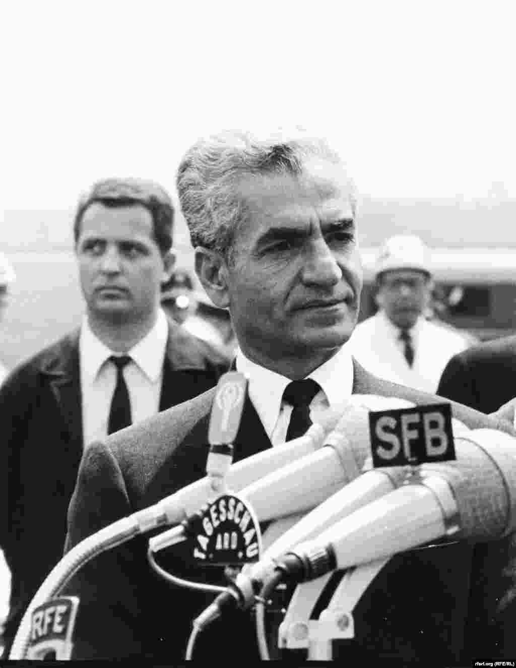Shah of Iran speaks into a RFE microphone during a 1968 diplomatic trip to Berlin . - Shah of Iran speaks into a RFE microphone during a 1968 diplomatic trip to Berlin .