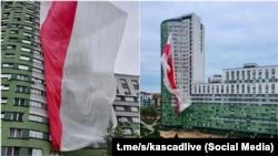 Бел-чырвона-белы сьцяг на доме ў мікрараёне Каскад у Менску