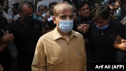 Pakistani opposition leader Shahbaz Sharif leaves the High Court in Lahore on September 24.