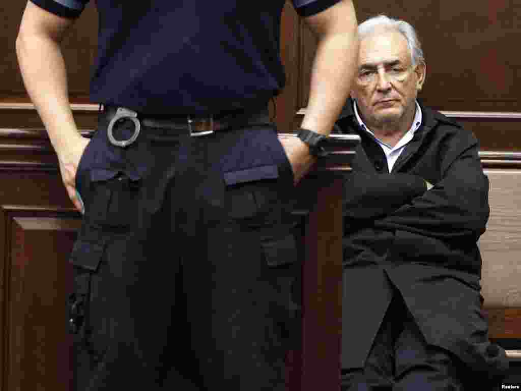 International Monetary Fund chief Dominique Strauss-Kahn appears in Manhattan Criminal Court during his arraignment after being accused of trying to rape a hotel maid in a case that sent shockwaves through French politics.Photo by Shannon Stapleton for Reuters