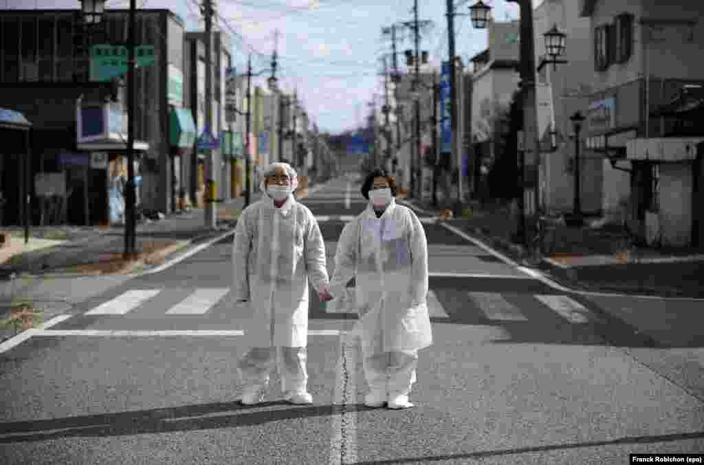 Yuzo Mihara (left) and his wife, Yuko, pose on a deserted street in the town of Namie, inside the nuclear exclusion zone near Fukushima, Japan, on February 22. Residents of the town were forced to abandon their homes after the 2011 nuclear disaster, and only return briefly to retrieve their belongings.