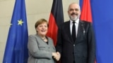 German Chancellor Angela Merkel and Albanian Prime Minister Edi Rama shake hands after holding a news conference at the Chancellery in Berlin, Germany