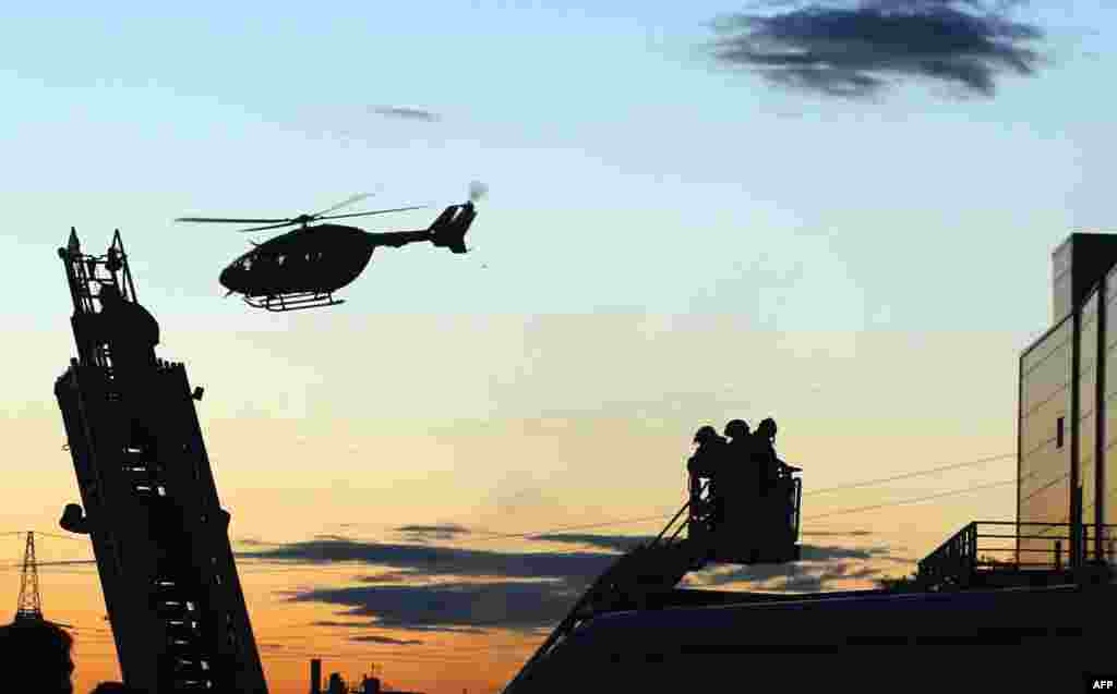 A helicopter flies above Moscow's Rio shopping mall following a fire there on July 10 that injured more than a dozen people. (AFP/Maxim Zmeyev)