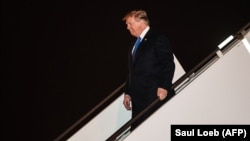 U.S. President Donald Trump disembarks from Air Force One at Noi Bai International Airport in Hanoi on February 26.