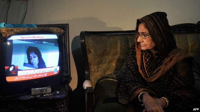 In Karachi, Ismat Siddiqui, the mother of Aafia Siddiqui, watches a news report following the court verdict against her daughter.