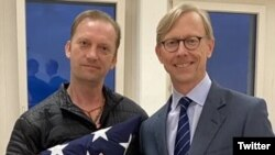 Michael White, a U.S. Navy veteran and U.S. Special Representative for Iran Brian Hook, after White's release. June 4, 2020