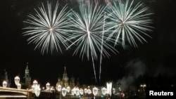 Fireworks light up central Moscow to welcome in New Year's Day.