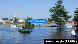 PHOTO GALLERY: Locals have been evacuated and services halted in a number of regions, including the inundated village of Ust-Ivanovka in the Amur Oblast.