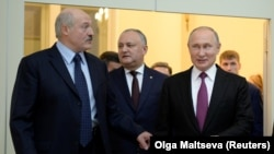 RUSSIA -- (R-L) Russian President Vladimir Putin, Moldovan President Igor Dodon and Belarusian President Alyaksandr Lukashenka attend a meeting of the Supreme Eurasian Economic Council in St. Petersburg, December 6, 2018