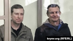 Volodymyr Dudka (left) and Oleksiy Bessarabov appear in court in Sevastopol on April 4.