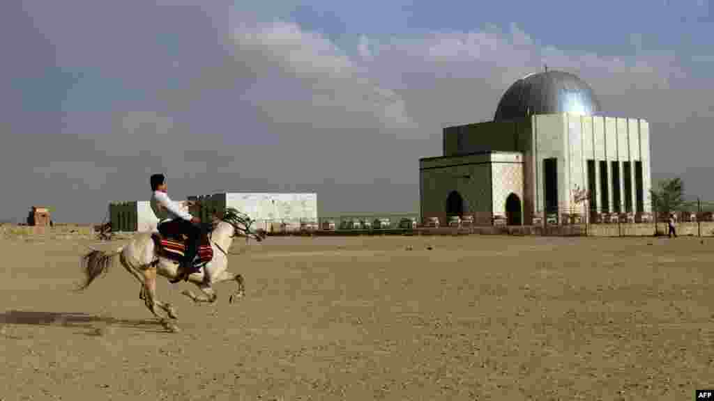 A man rides his horse near the tomb of Nadir Khan in Kabul, Afghanistan, on October 18. (AFP/Munir uz Zaman)