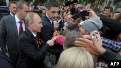 Ռուսաստանի նախագահ Վլադիմիր Պուտինը Սևաստոպոլ այցի ժամանակ, 9-ը մայիսի, 2014թ․