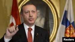 Turkish Prime Minister Recep Tayyip Erdogan was the apparent target of a man carrying a fake bomb. (file photo)