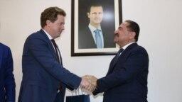 Глава российской администрации Севастополя Дмитрий Овсянников и министр транспорта Сирии Али Хамуд. Сирия, Дамаск, 15 января 2019 года