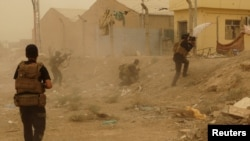 Iraqi forces fighting in the Islamic State militants in May.