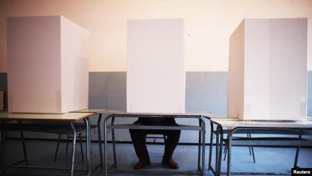 A man casts his vote at a polling booth in Potocari, near Srebrenica.