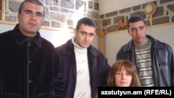 Armenia - Former soldiers Musa Serobian (L) Arayik Zalian (C) and Razmik Sargsian pose for a photograph with their laywer Zaruhi Postanjian two months after their unexpected release from jail, Yerevan, 28Feb2007.