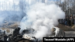 FILE: Smoke billows from the remains of an Indian Air Force aircraft after it crashed in Budgam district, on the outskirts of Srinagar on February 27.