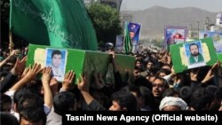A funeral for four Afghan refugees who were killed in Syria was held in the Iranian city of Mashhad on May 15.