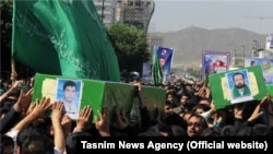 A funeral is held in the Iranian city of Mashhad for four Afghan refugees who were killed in action in Syria. (file photo)
