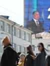 An electronic screen, installed on the facade of a building in Yekaterinburg, shows Russian President Vladimir Putin as he delivers his annual address on April 21.