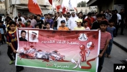 Shi'ite Muslims protest the killing of a protester in a suburb of Bahrain's capital Manama