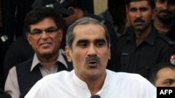 Pakistani Minister for Railways Khawaja Saad Rafique talks to the media outside a court in Lahore on May 4.